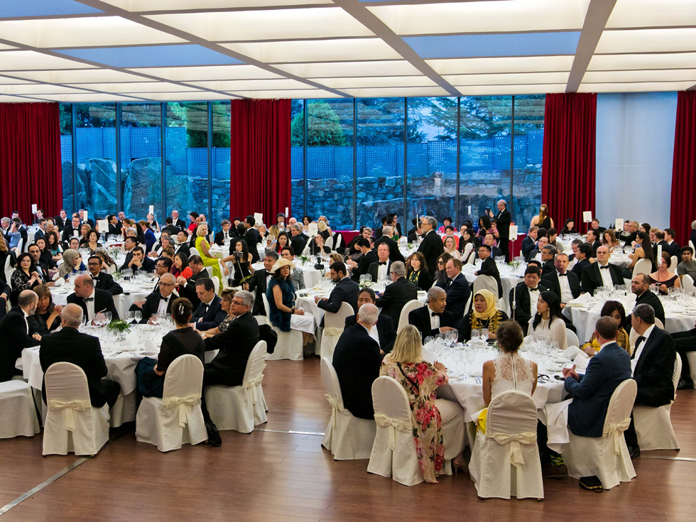 Large group of people at a gala dinner.